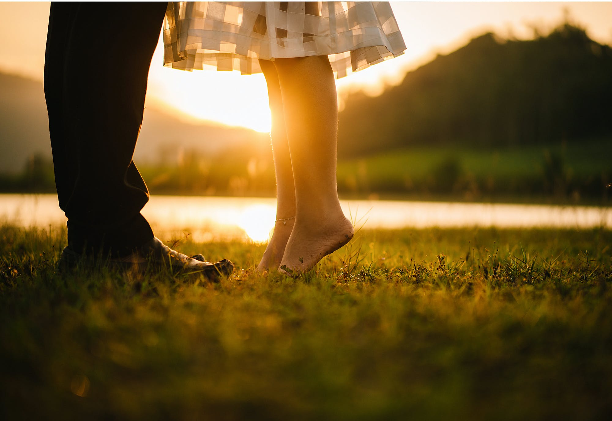 Man and Woman Standing on Green Grass