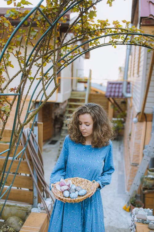 Girl in Blue Long Sleeve Shirt Holding Brown Basket