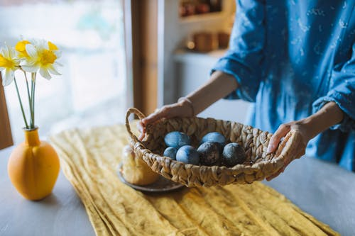 Woman Holding an Egg Basket
