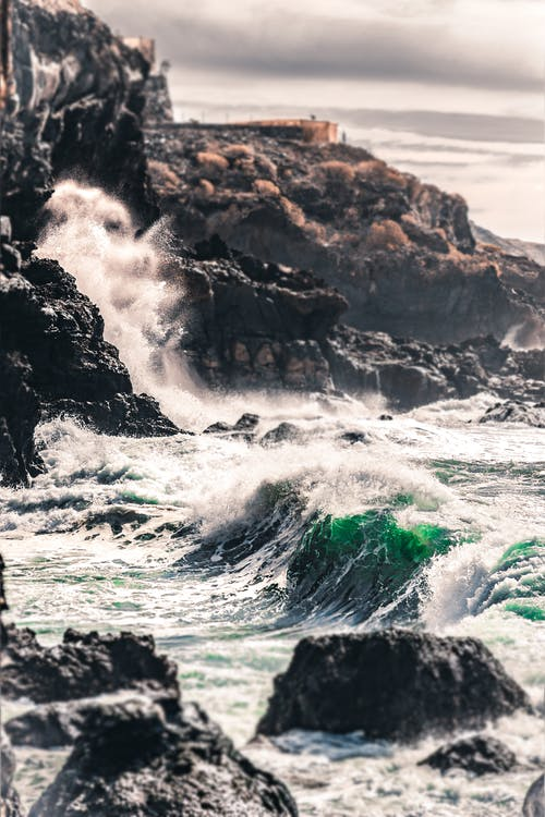 Photo Of Waves Crashing On Rocks