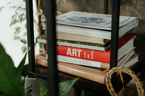 Red and Brown Books on Brown Woven Basket