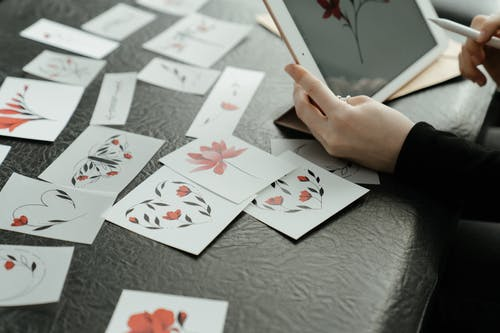 Person Holding 6 of Diamonds Playing Cards