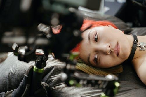 Woman in Black Jacket Lying on the Floor