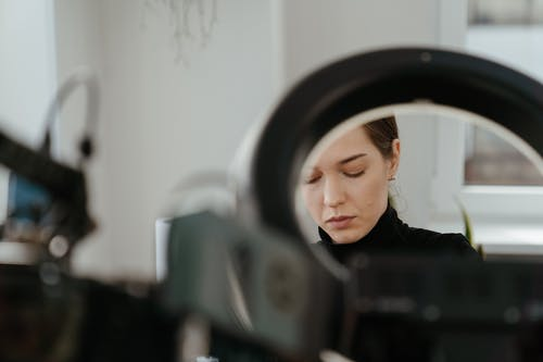 Woman in Black Shirt Looking at the Mirror