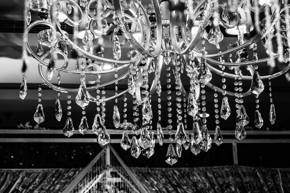 Grayscale Photo of Glass Chandelier