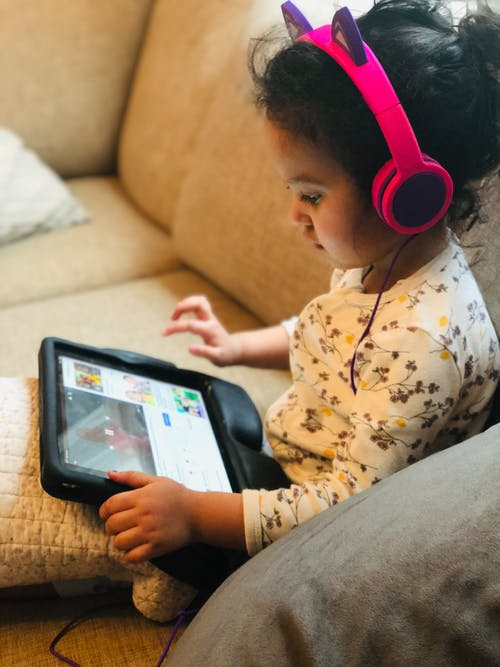 Photo Of Child Using Tablet