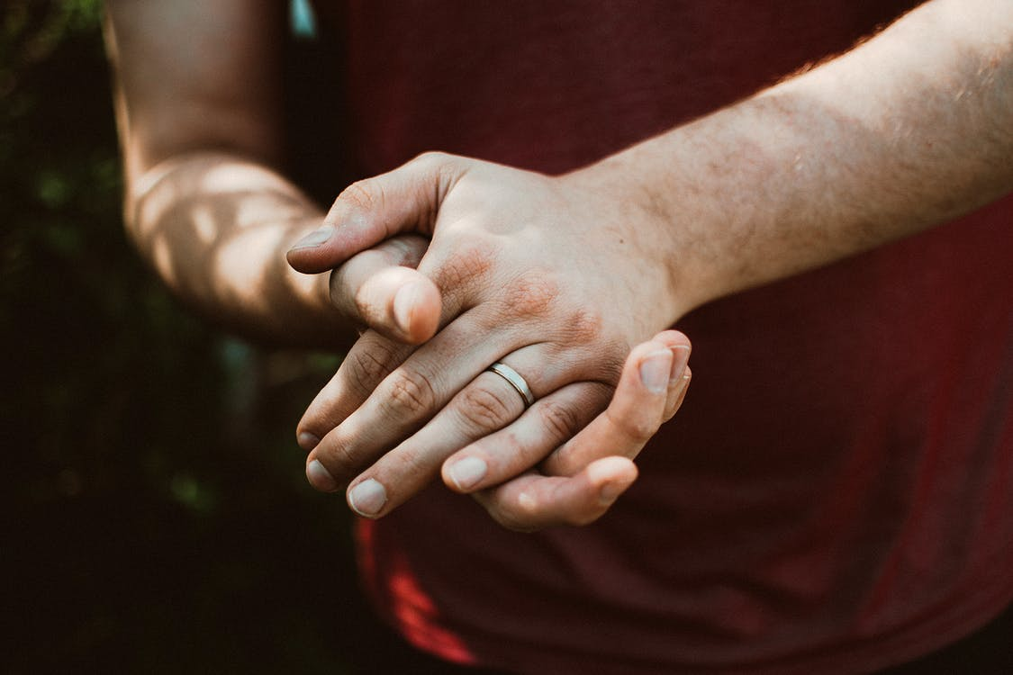 Photo Of Person Wearing Ring