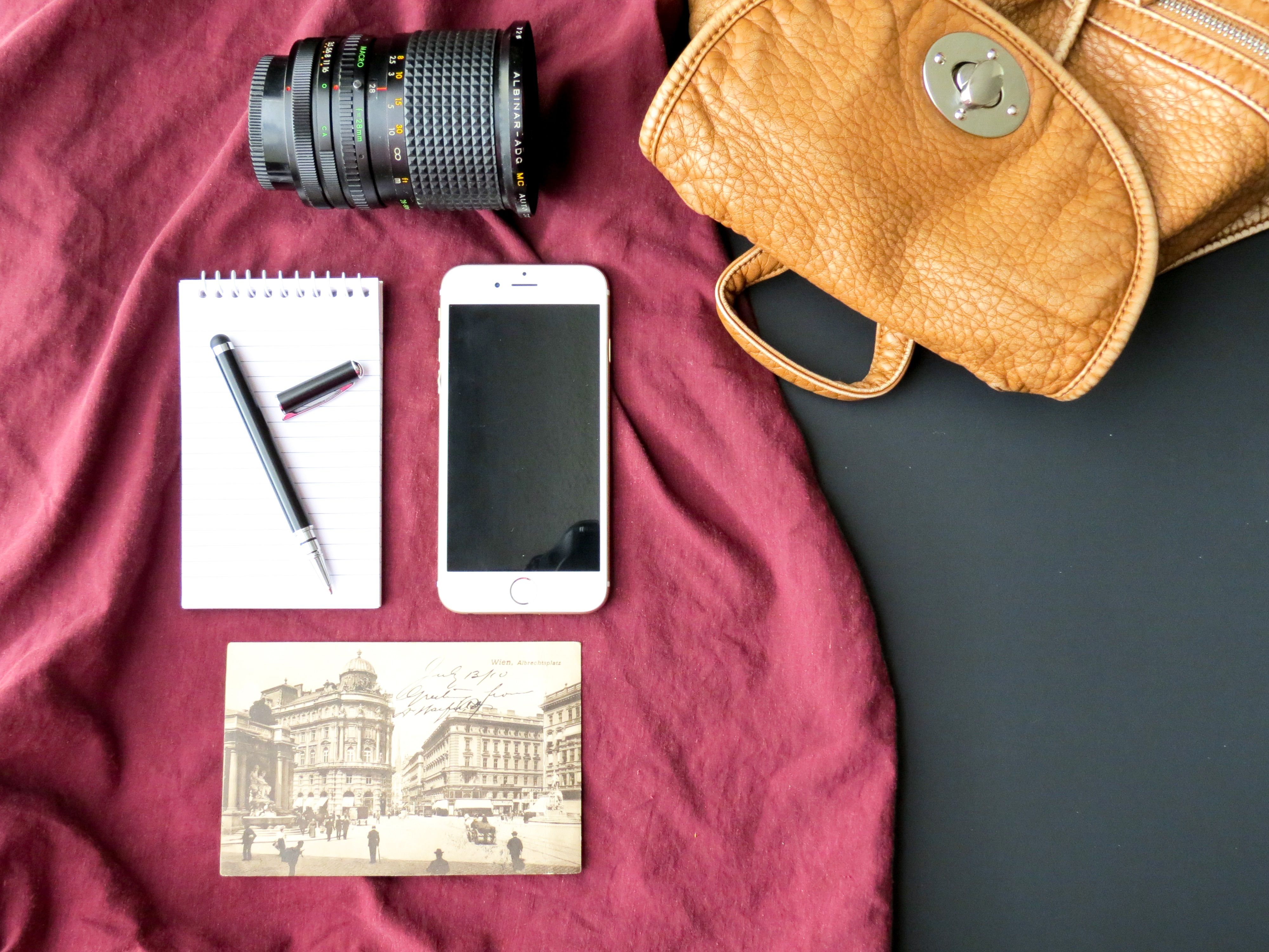Flat Lay Photography of Iphone, Notebook, and Dslr Lens