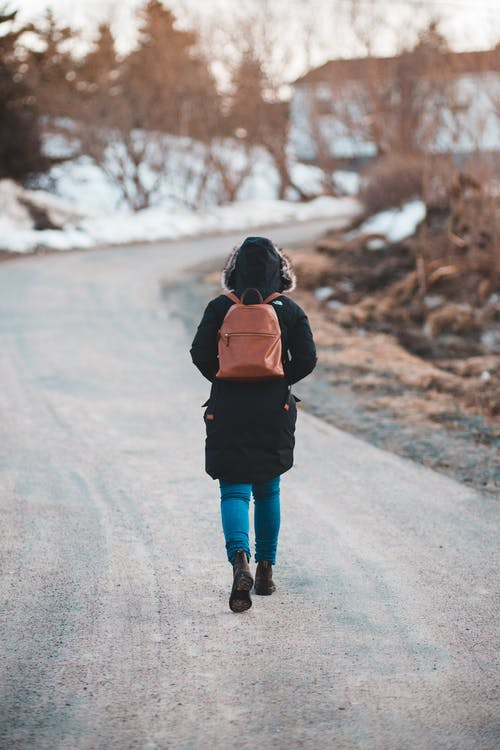 Photo Of Person Walking On Road