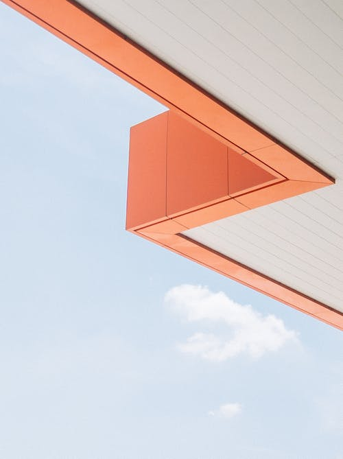 Angle of orange roof and sky with clouds