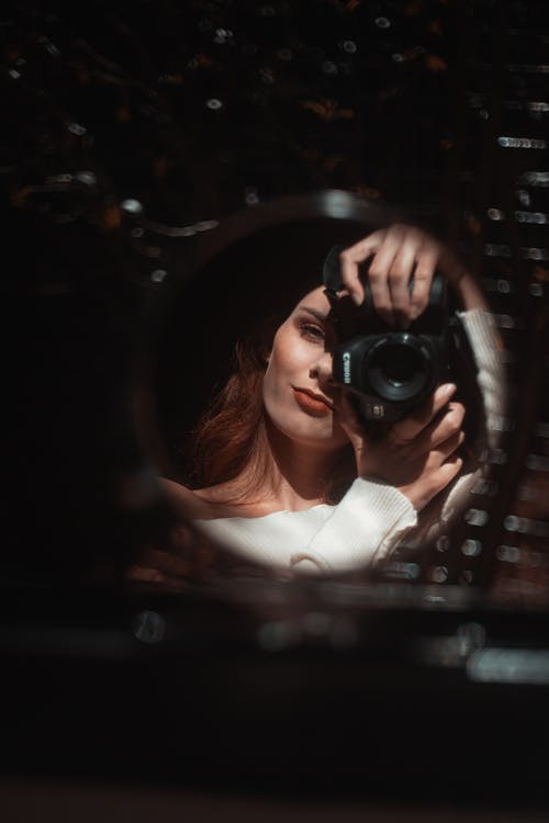 Beautiful woman taking mirror selfie