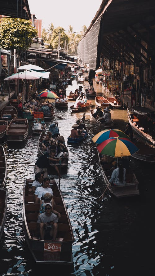 People Riding Boats on River