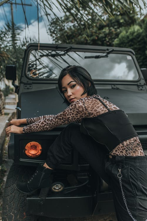 Photo Of Woman Leaning On Car