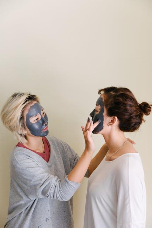 Women Putting Beauty Masks