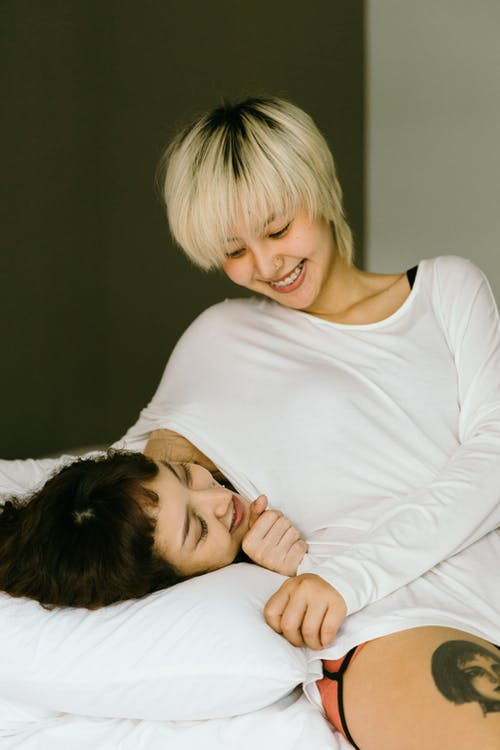 Women Smiling in Bed