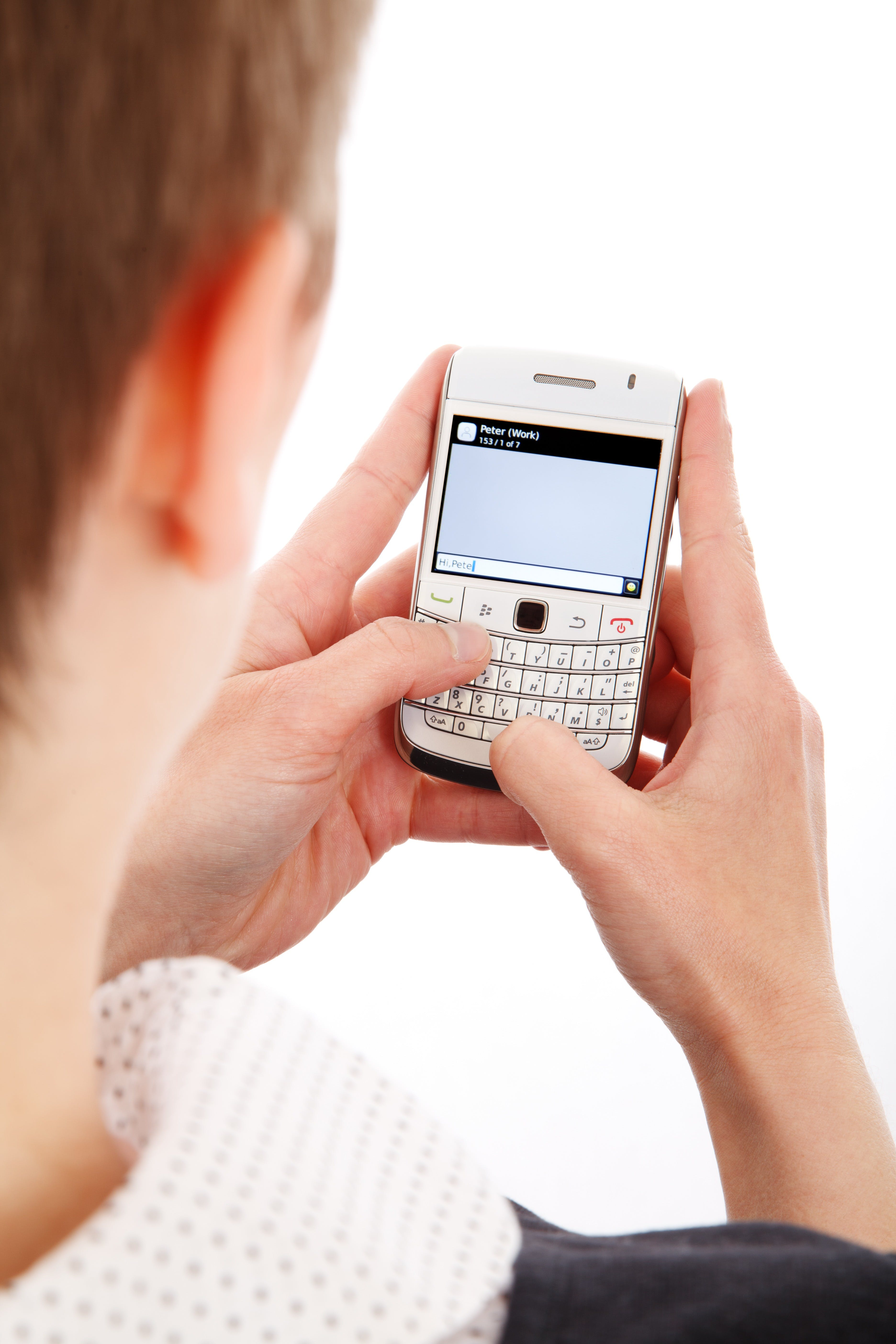 Person in White Top Using White Qwerty Phone