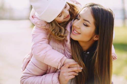 Happy mother and daughter spending time together on urban street