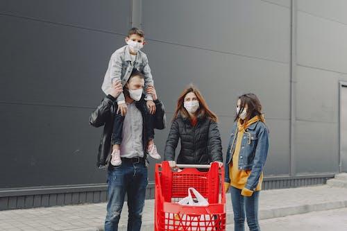 3 Women and 2 Men Standing on Gray Concrete Floor