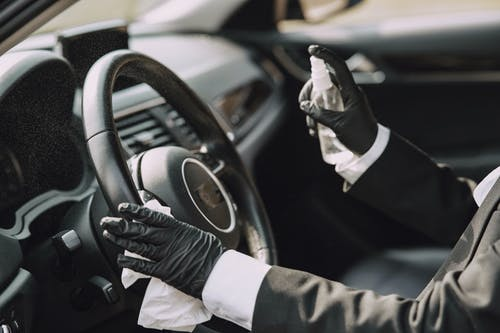 Man in Black Suit Driving Car