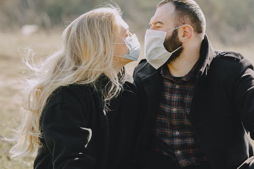 Man in Black Jacket Kissing Woman in White Hijab