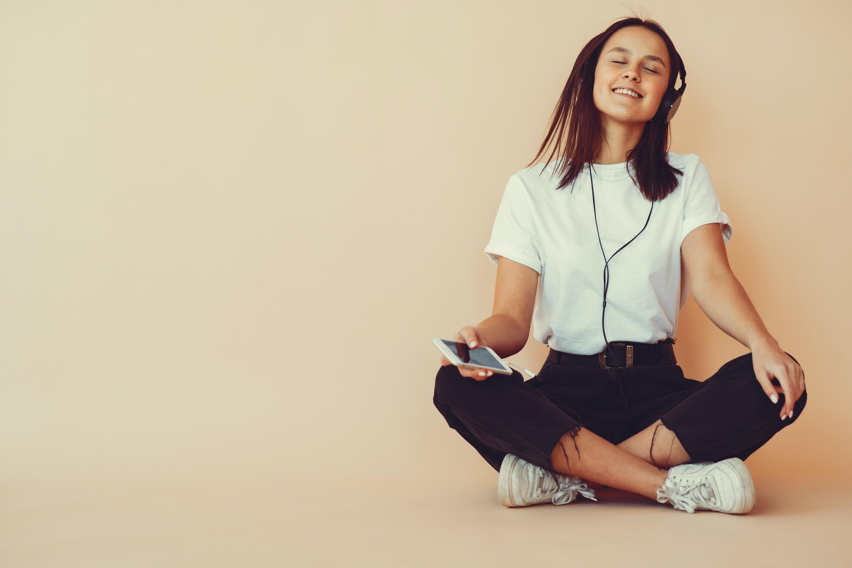 Muslim woman listening to music on headphones Photo | Free ... |Woman Listening To Music