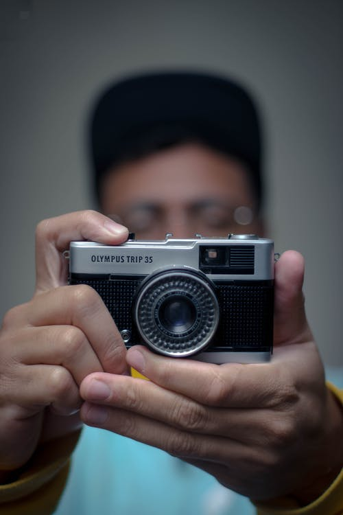 Unrecognizable man taking photo
