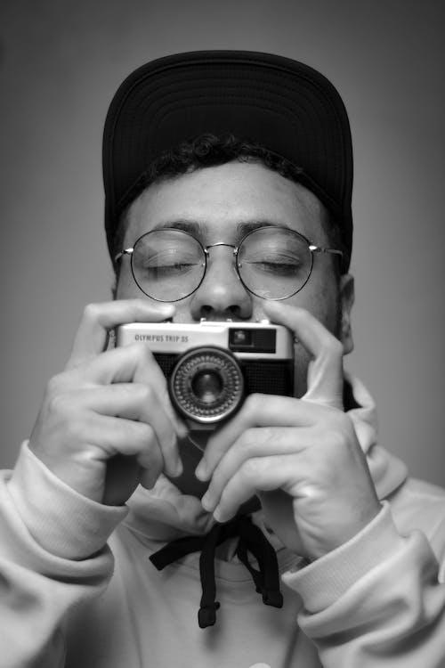Monochrome Photo Of Man Holding Camera