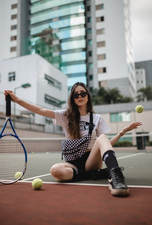 Photo Of Woman Holding Racket