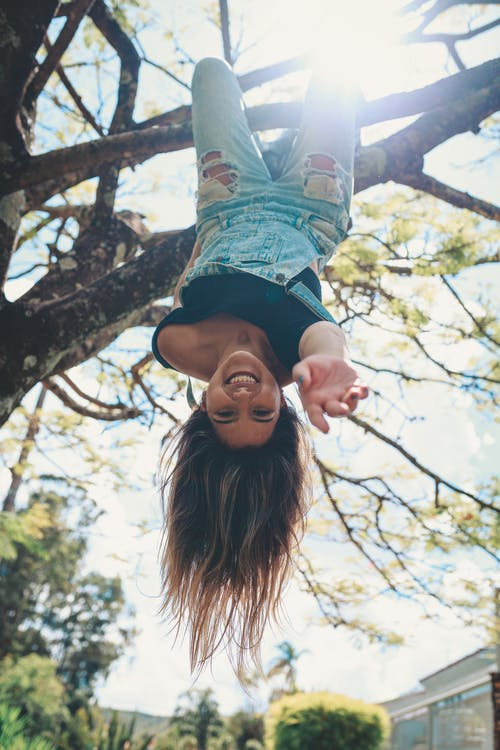 Photo Of Woman Hanging On The Tree Upside Down