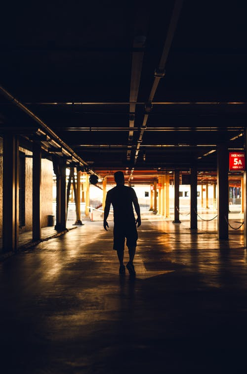 Silhouette of man on parking area