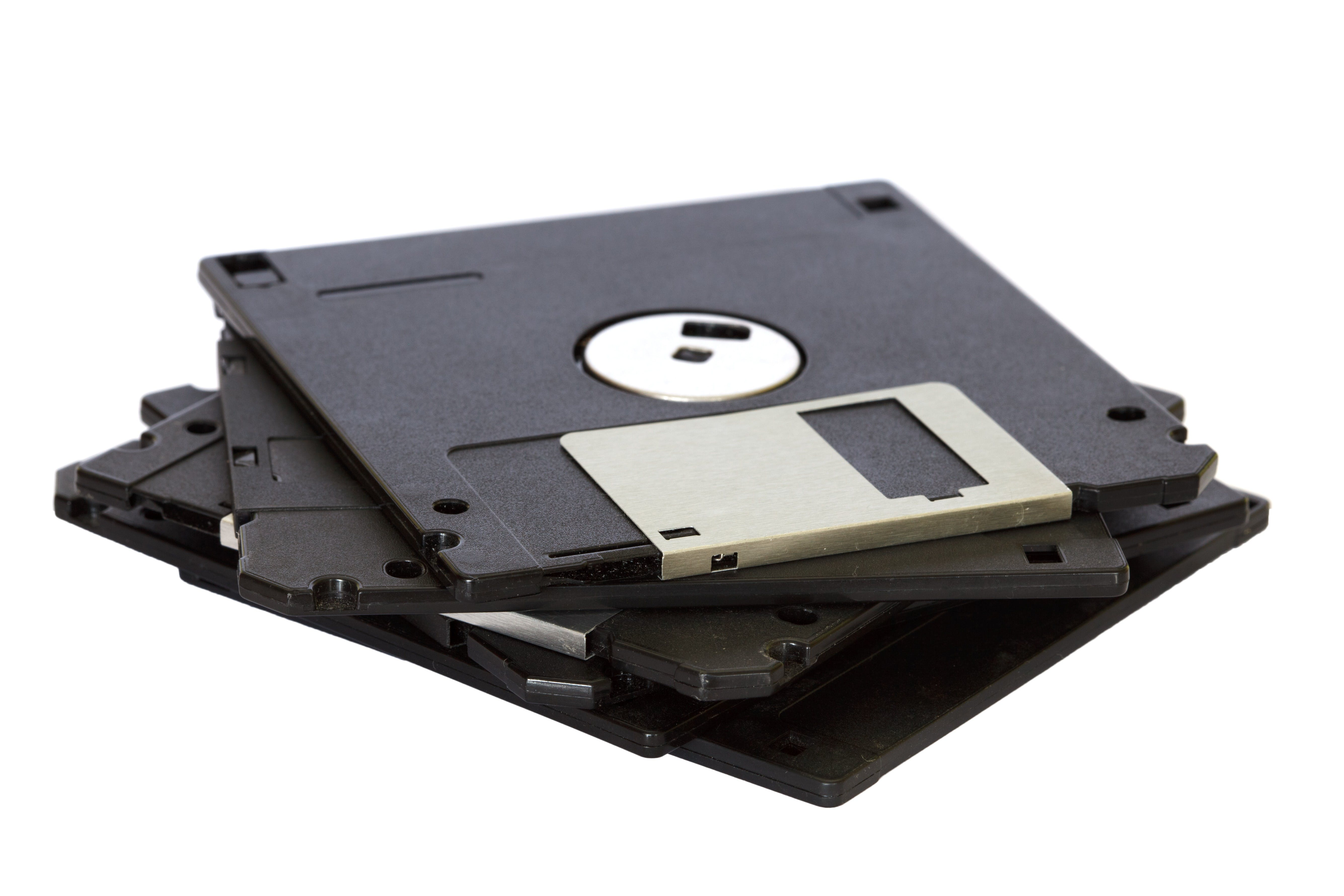 Four Black Floppy Discs on White Surface