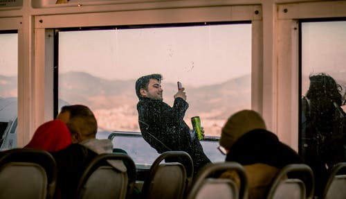 Man in Black Jacket Holding Smartphone