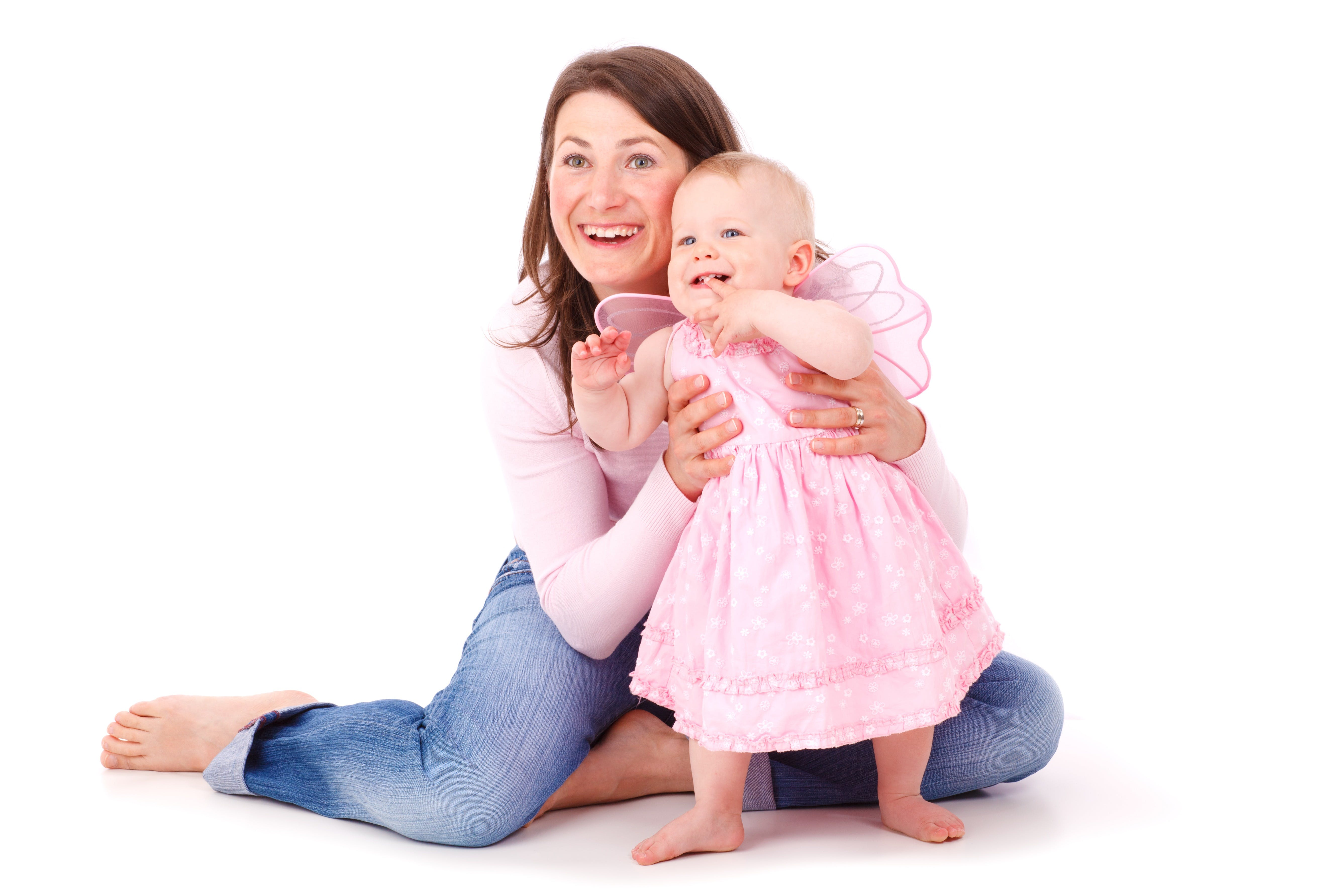 Woman Holding the Waist of Baby Girl in Pink Dress