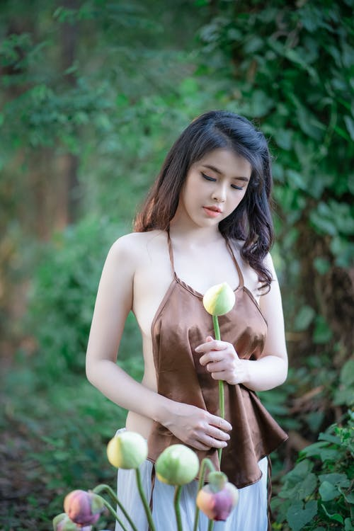 Alluring model with flower in green summer
