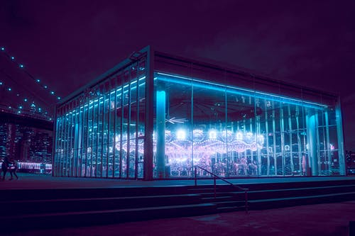 Blue Glass Building during Night Time