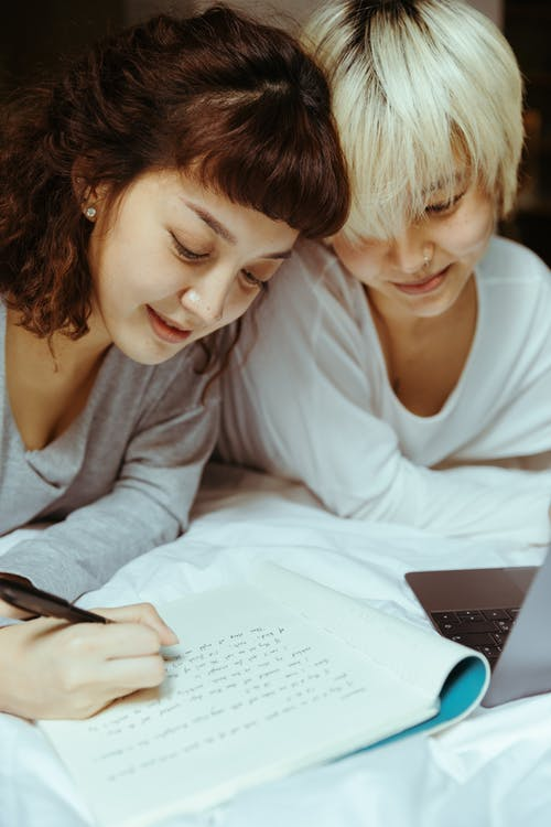 Young Women Studying Together