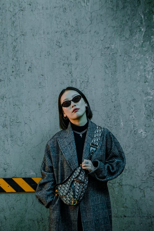 Cool grunge lady in coat and sunglasses