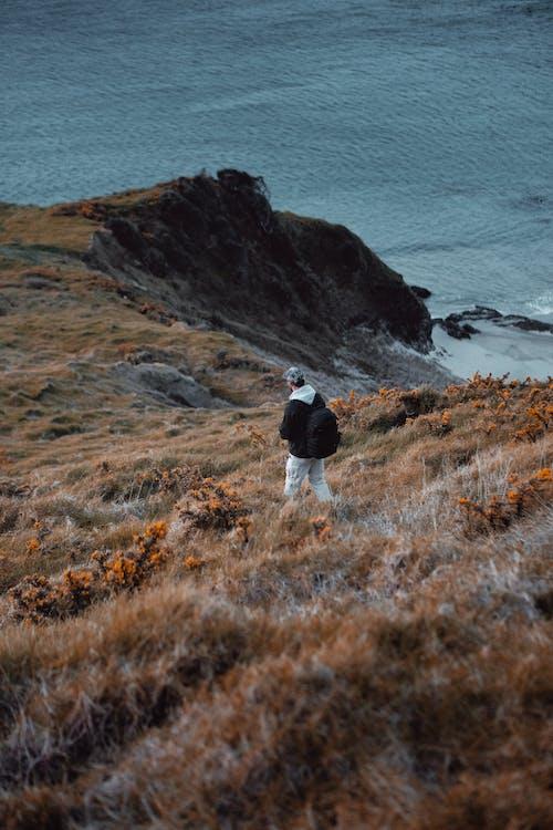 Man Hiking on Coast