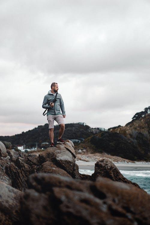 Man Standing on Coast