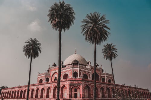 Facade of old temple with tomb of Humayun in Delhi