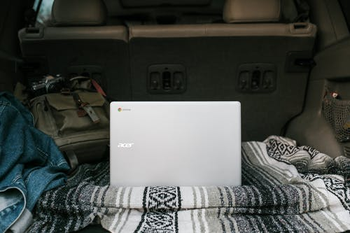 White Asus Laptop on Gray Car Seat