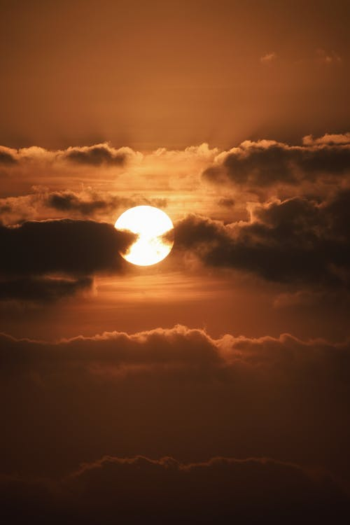 Dark clouds and sun over evening sky