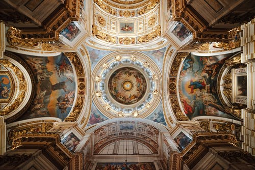 Painted majestic ceiling of ornamental cathedral