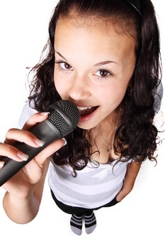 Woman Holding Black Microphone