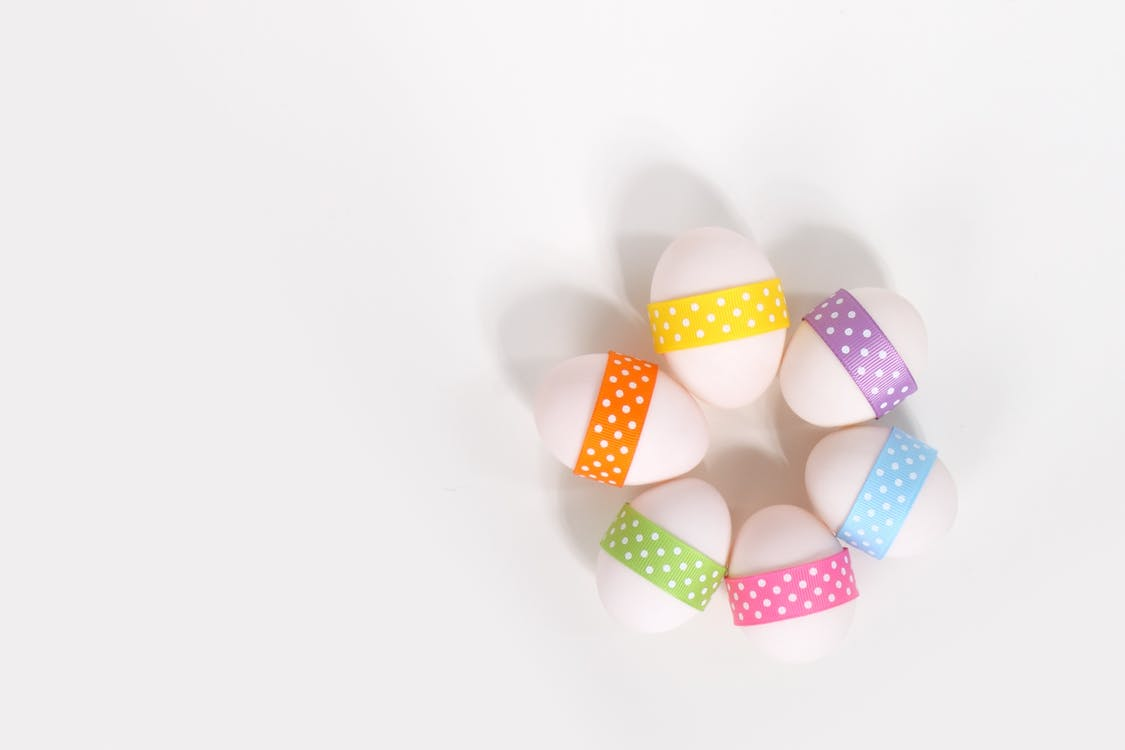 Six Oval Assorted-color Ornaments on White Surface