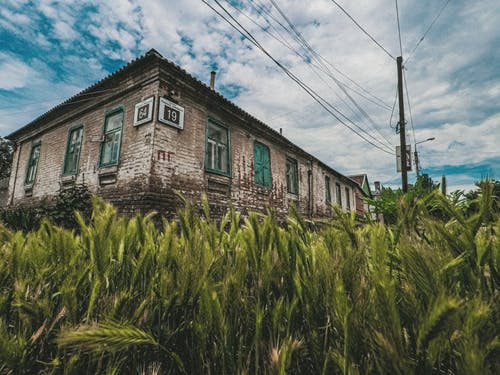 Abandoned building corner near agricultural field