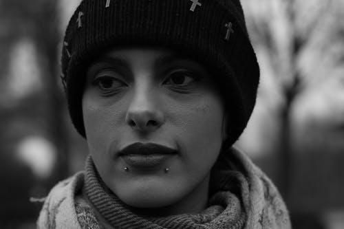 Grayscale Photography of Woman With Piercings