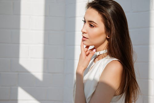 Woman in White Top Posing for Picture