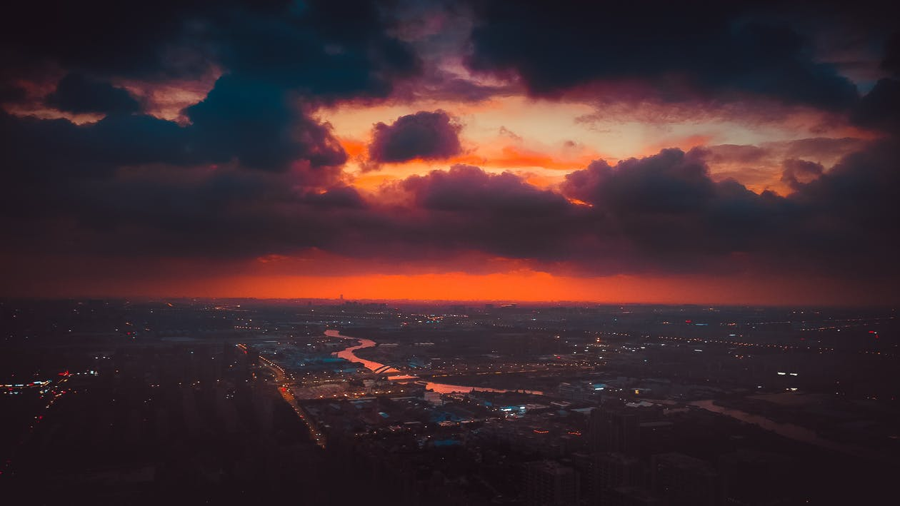 Aerial Shot of a City Under a Cinematic Sky