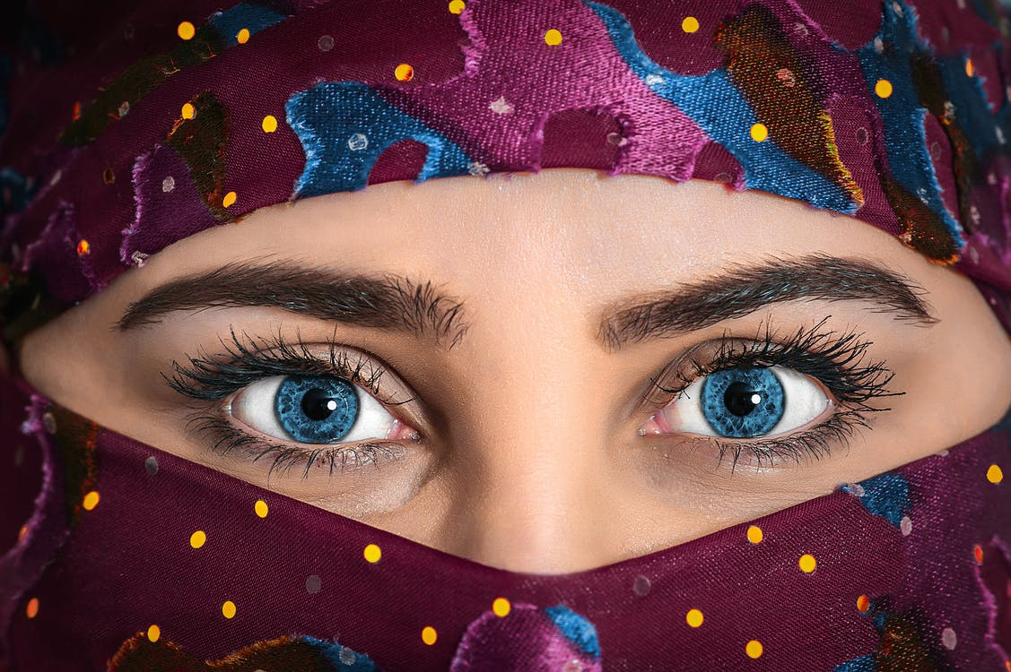 Woman With Blue Eyes Wearing Purple Hijab Scarf